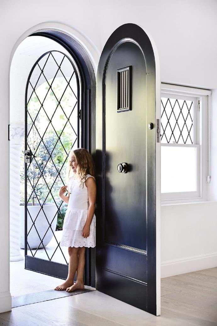 **Entry** Daughter Zoe stands at the arched doorway Photographer: Derek Swalwell, Stylist: Rachel Vigor