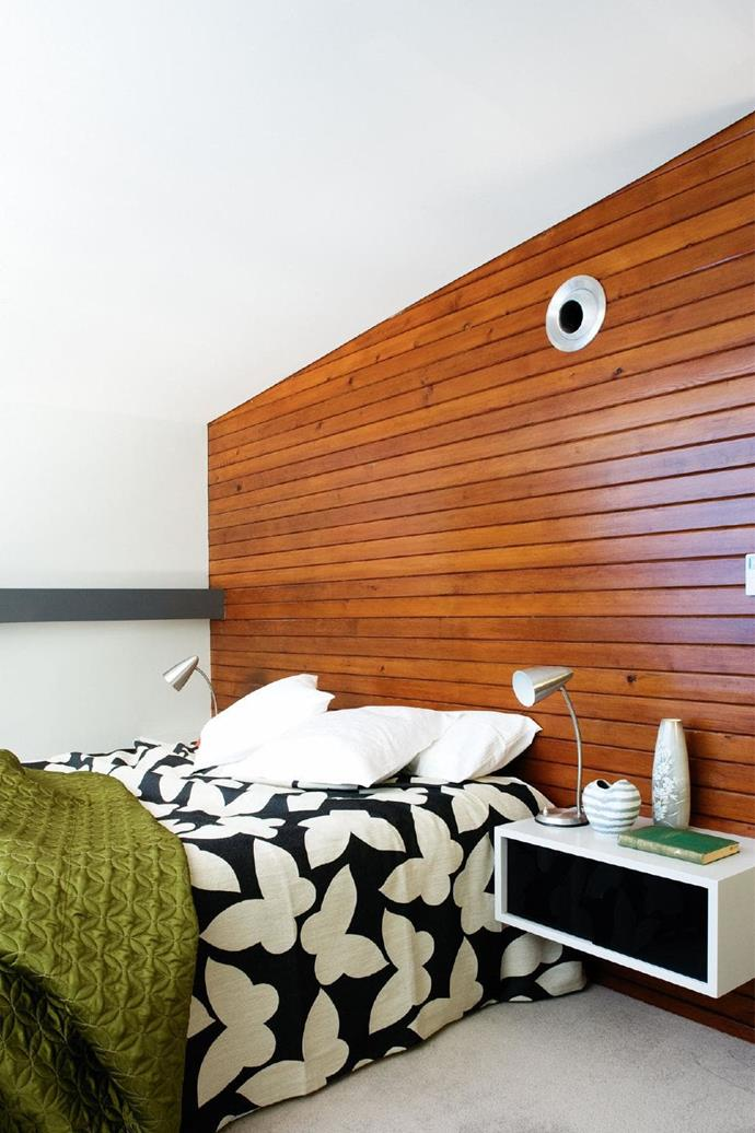 Cedar wall panelling is repeated in various rooms, including the living/dining area, which is in the original section of the house. Panelling is used again as a full feature wall in the master bedroom.