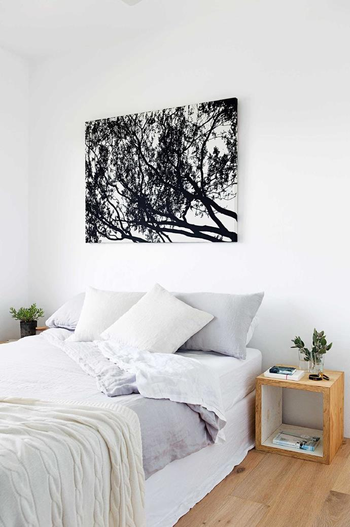 """A pair of simple cube bedside tables fit in nicely with the home's understated style. A calm atmosphere comes to the fore, from a nature-inspired [Marimekko](https://marimekko.com/se_en/