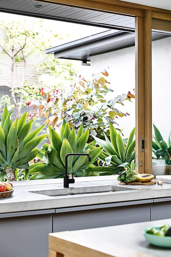 "**SLIDING WINDOWS** <br><br>Placing your sink in front of a window is hardly revolutionary, but a sliding window that reaches all the way to the ceiling is next-level thinking. It also opens up the opportunity to include a [servery window bench](https://www.homestolove.com.au/servery-window-kitchen-19958|target=""_blank"") for entertaining outside, or plenty of lush greenery that connects you to the garden in a very real way. Extra points for setting the runners at the same height as the bench for a seamless look.<br><br>"