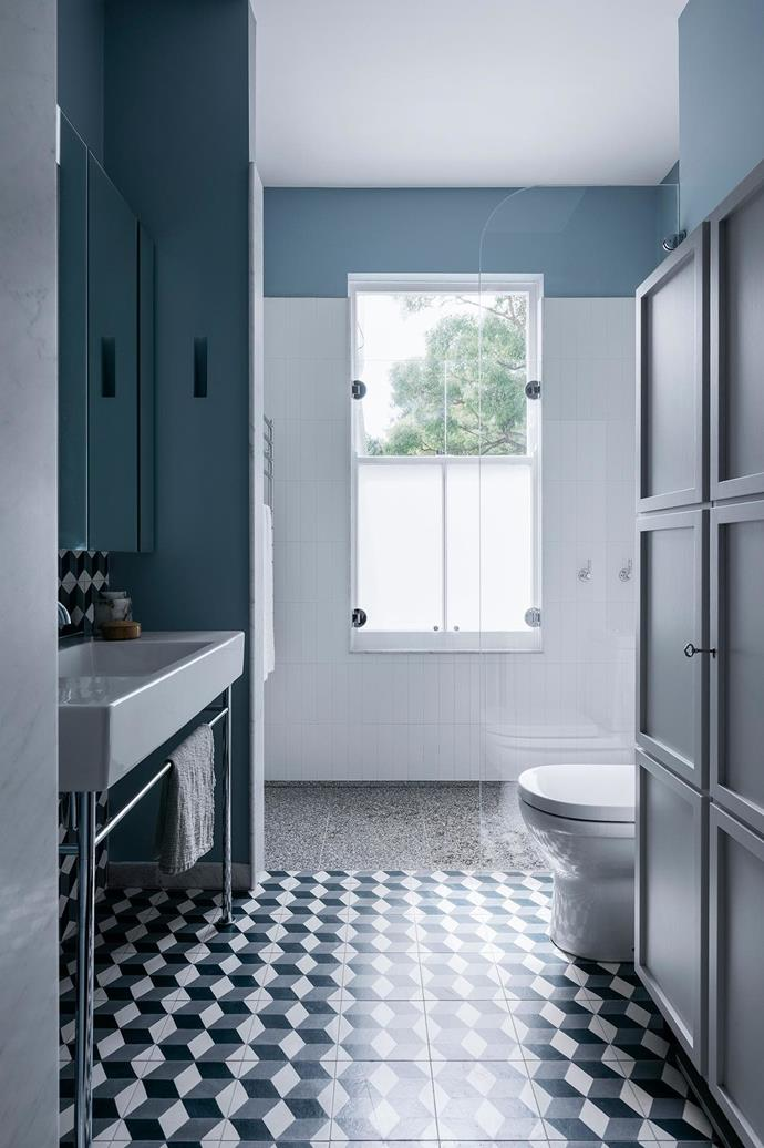 Muted blues and grey contrast with an array of tiles and patterns in this wet zone.