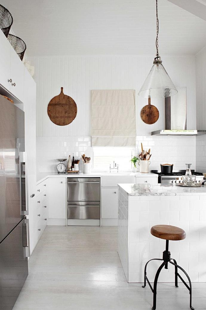 Polished silver and timber elements give this white kitchen a provincial feel. Want more? Try [20 best modern bathrooms](http://www.insideout.com.au/renovations/bathroom/20-best-modern-bathrooms?ret=%2Fsearch%3Fq%3D20%2Bbest%2Bmodern%2Bbathrooms) Photographer: Kara Rosenlund, Stylist: Megan Morton