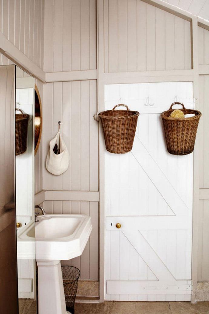 "A simple and inexpensive way to add storage to a bathroom is to use the available space behind the door. Hang [baskets](https://www.homestolove.com.au/storage-baskets-13356|target=""_blank"") from hooks as shown in this [country-inspired bathroom](https://www.homestolove.com.au/country-bathrooms-13321
