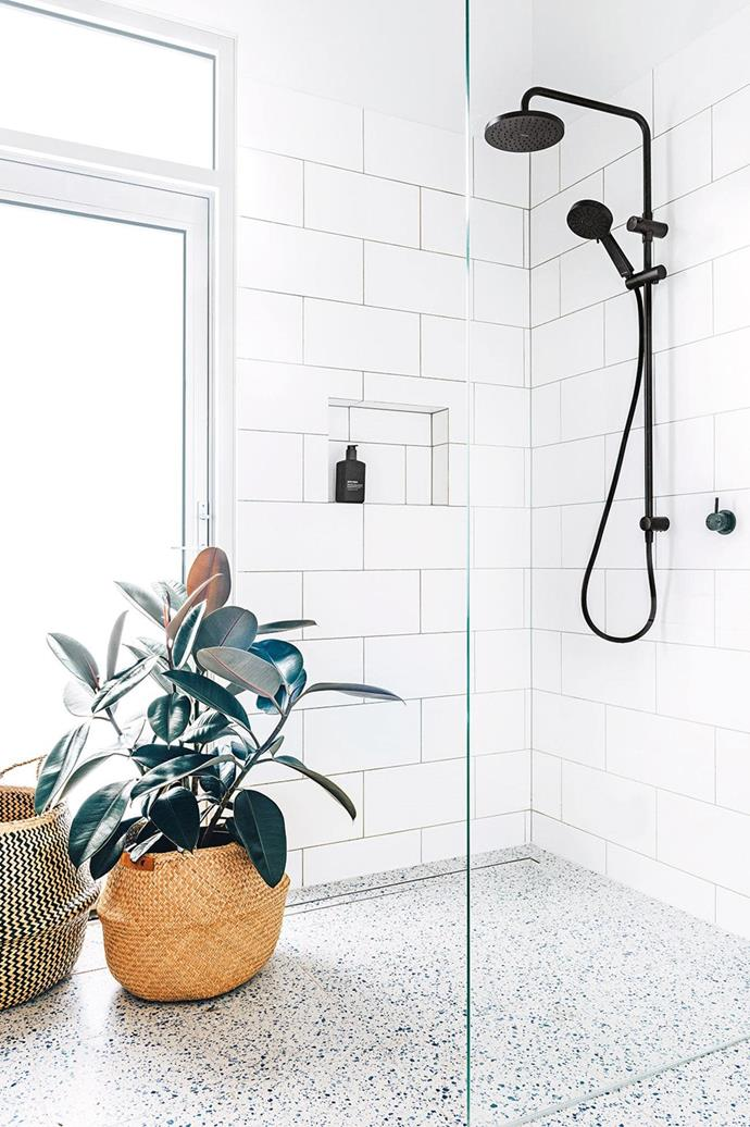 "When it comes to bathroom styling, you can never go wrong with an indoor plant! [Rubber trees](https://www.homestolove.com.au/minimalist-indoor-plants-6494|target=""_blank"") (*ficus elastica*) are especially popular in monochromatic homes as their dark green leaves appear almost black."