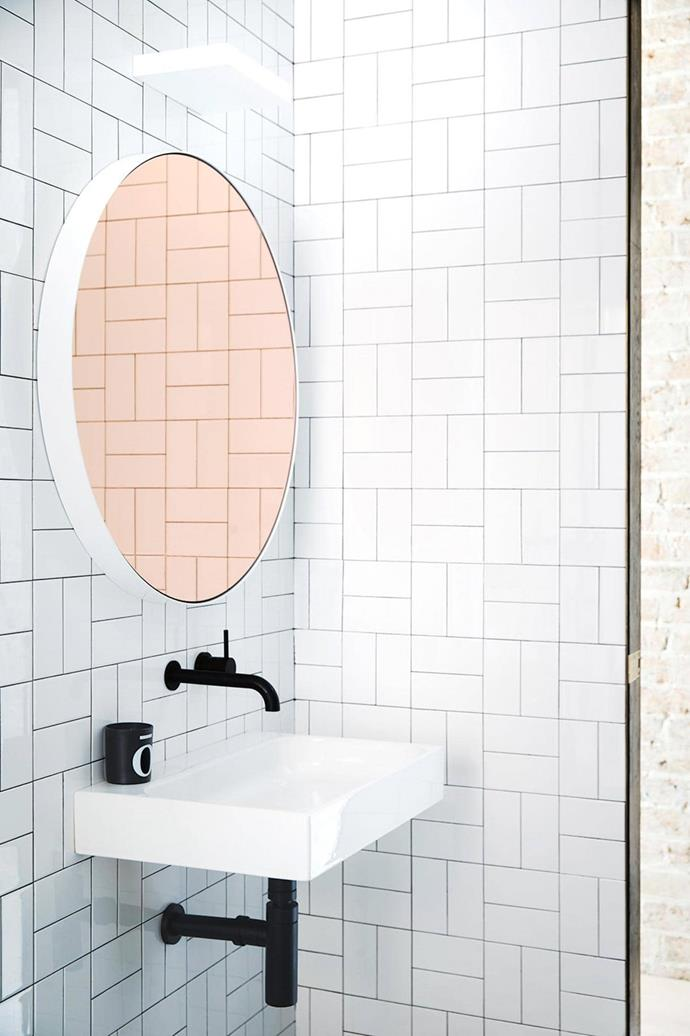 "The graphic geometric wall tiles used in this black and white bathroom in a [renovated Victorian terrace house](https://www.homestolove.com.au/how-to-mix-timber-with-brick-and-marble-in-a-victorian-terrace-17432|target=""_blank"") were sourced from Earp Bros. *Photo: Chris Warnes. Stylist: Stephanie Powell*"