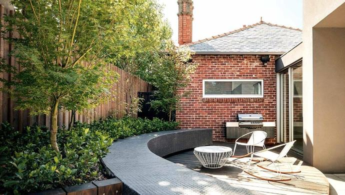 The sculptural leaves of the century plant complement the zone's striking curves. This tiled garden bed wall acts as a counterpoint to the garden and pool area's straight lines, offering playful geometrics with its hexagon tiles. See more of this garden [here](http://www.insideout.com.au/renovations/outdoors-pool/6-ideas-to-steal-from-this-impressive-entertaining-haven?ret=%2Fsearch%3Fq%3Dhaven). Landscape architect: [Nathan Burkett Design](http://nathanburkett.com.au) Photographer: John Wheatley