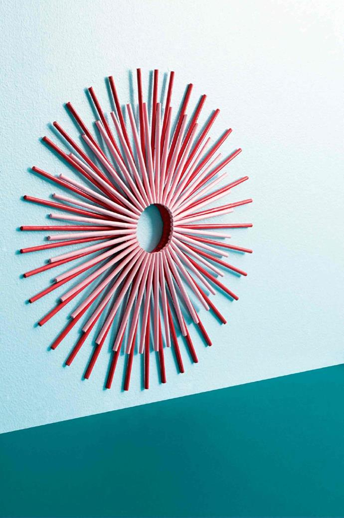 """BY [Natalie Turnbull](http://www.natalieturnbull.com.au/), stylist: """"I wanted to create a modern wreath with a colour palette that refers to minty-fresh candy canes. I was keen to keep the traditional elements of a Christmas wreath intact, and use uneven dowel pieces to create a geometrically shaped feature. To me, pink and red best encompass the spirit of Christmas. Pink, while not super traditional, offers a modern twist. Plus, I really can't get enough of this combo at the moment. With a project, I always try to create an object or image that showcases something in a new way. This candy-stripe wreath is my attempt at showing people something they are familiar with but giving it a new spin"""" Photographer: Craig Wall, Stylist: Jessica Hanson"""