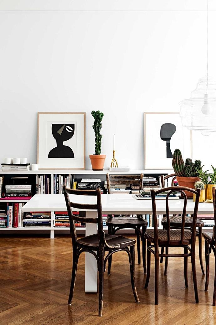 """Evelina and Stefan are both designers, so it's no surprise to find their home filled with [inspiring coffee-table books](https://www.homestolove.com.au/design-coffee-table-books-19708 target=""""_blank""""). Evelina favours a blend of vintage and modern pieces and the dining setting epitomises this. The chairs were found in vintage stores around Stockholm."""