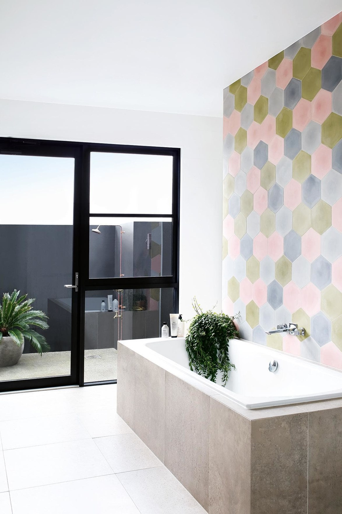 """Pastel statement tiles the first thing the owner purchased during the renovation of their [laid-back family home](https://www.homestolove.com.au/pops-of-pastel-and-laid-back-glamour-are-the-stars-of-this-family-home-18340