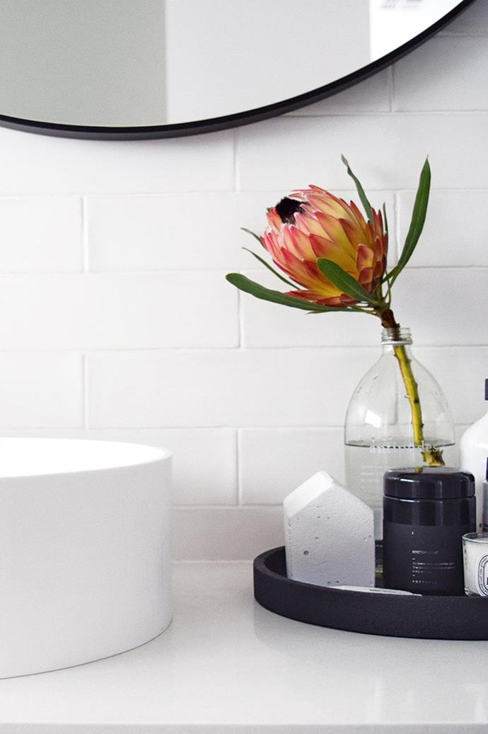 "[Styling small vignettes](https://www.homestolove.com.au/how-to-style-a-vignette-5757|target=""_blank"") in the bathroom can transform what can quickly feel like a clinical space into a luxurious sanctuary."