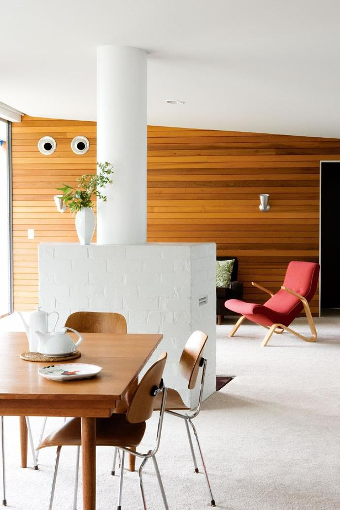 """Cedar wall panelling is repeated in various rooms, including the living/dining area, which is in the original section of the house. Unlike most houses built in Australia at the time, this home had a [fireplace](https://www.homestolove.com.au/cosy-fireplaces-that-will-warm-your-heart-3475