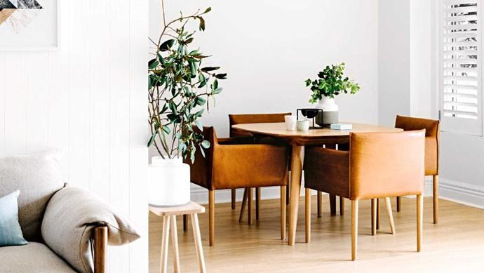 The strong lines and simple designs of the Case Furniture 'Bridge' table from Aero Designs and Jardan 'Maggie' chairs suit the Scandinavian-inspired space perfectly. Pot plants add life to the minimalist look Photographer: Brooke Holm, Stylist: Marsha Golemac