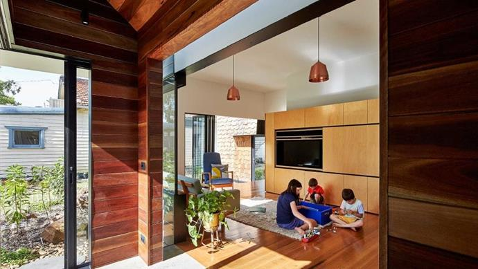 A studio, bedroom, bathroom, kitchen and dining area occupy the new part of the house.