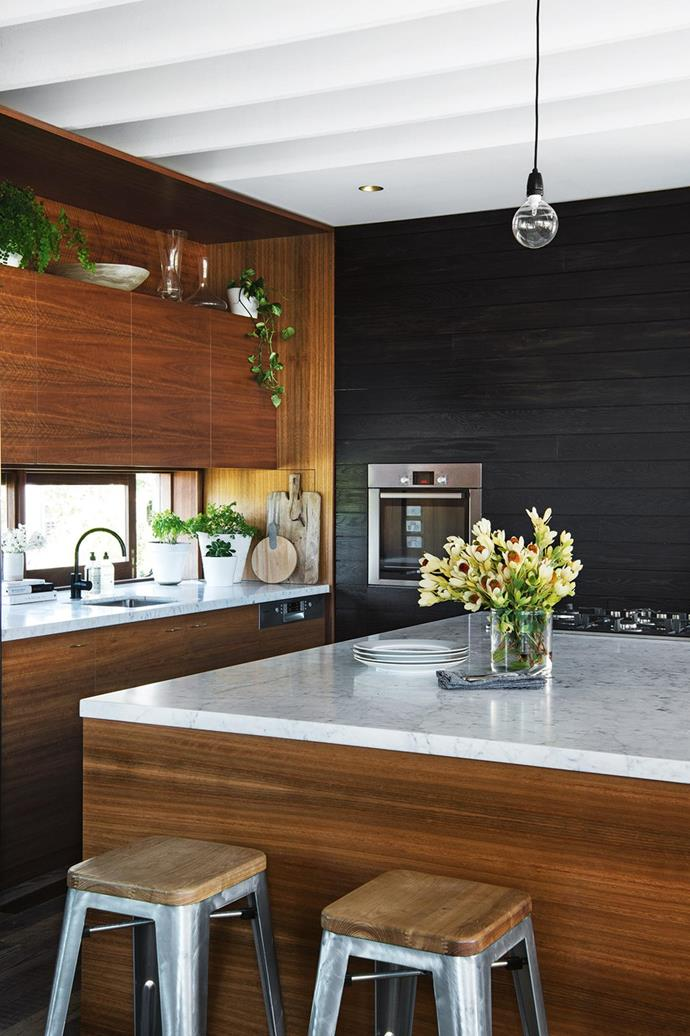 "Lightly veined marble benchtops pop in this timber kitchen in a [newly built Sydney beach house](https://www.homestolove.com.au/tour-a-sydney-beach-house-a-year-in-the-making-16563|target=""_blank""). *Photographer: Brigid Arnott*"