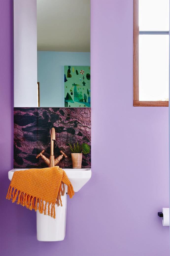 The smallest room in the house has a big impact, thanks to a slab of crocodile bamboo quartzite from [Peraway Marble](http://www.perawaymarble.com.au/), purple paint and Brodware tapware from [Mary Noall](http://www.marynoall.com.au/). Photography by Nikole Ramsay.