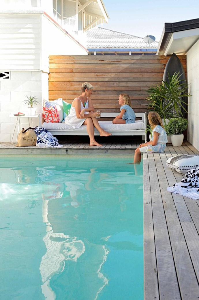 """Natural timber decking and a [daybed](https://www.homestolove.com.au/resting-pose-12-beautiful-daybeds-3591