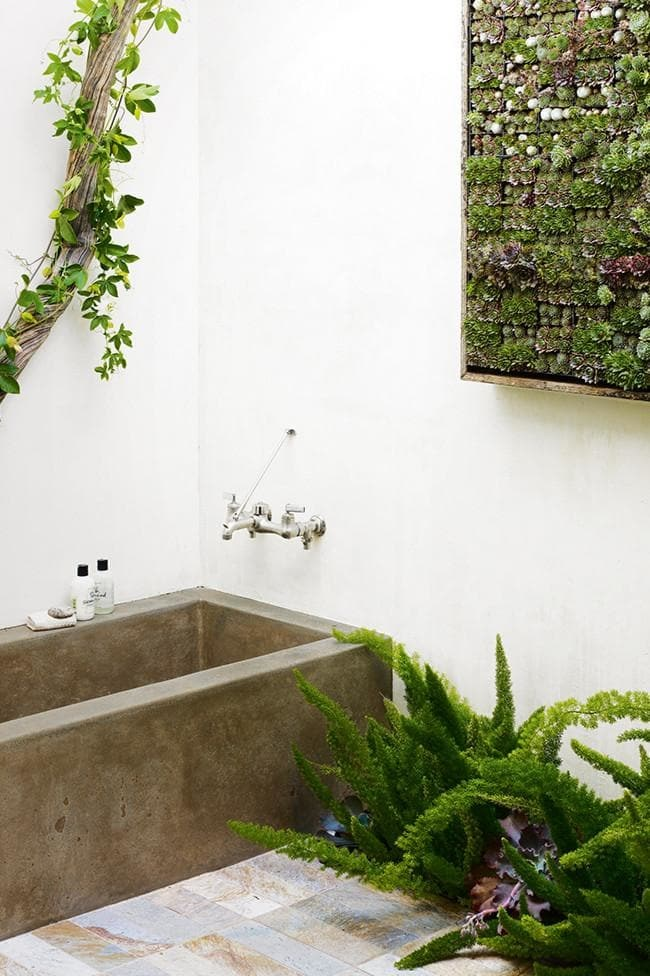 Use moisture-loving plants, such as moss and ferns, in the bathroom to create your own luscious oasis, adding a sense of tropical bliss to your pamper zone. Photo credit: Jen Siska for Flora Grubb Gardens