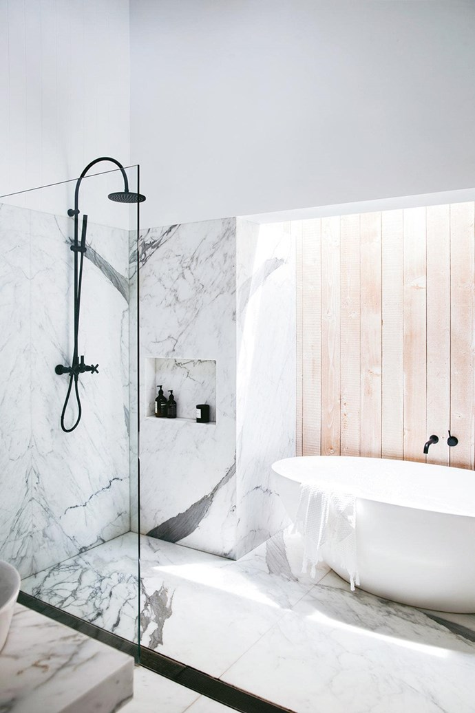 """An Oregon [timber wall in the bathroom](https://www.homestolove.com.au/the-best-white-and-timber-bathroom-designs-17765