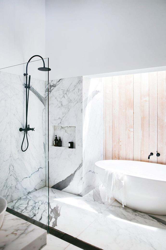 "An Oregon [timber wall in the bathroom](https://www.homestolove.com.au/the-best-white-and-timber-bathroom-designs-17765|target=""_blank"") softens the space where calacatta marble dominates. *Photo: Chris Warnes / Stylist: Stephanie Powell*"