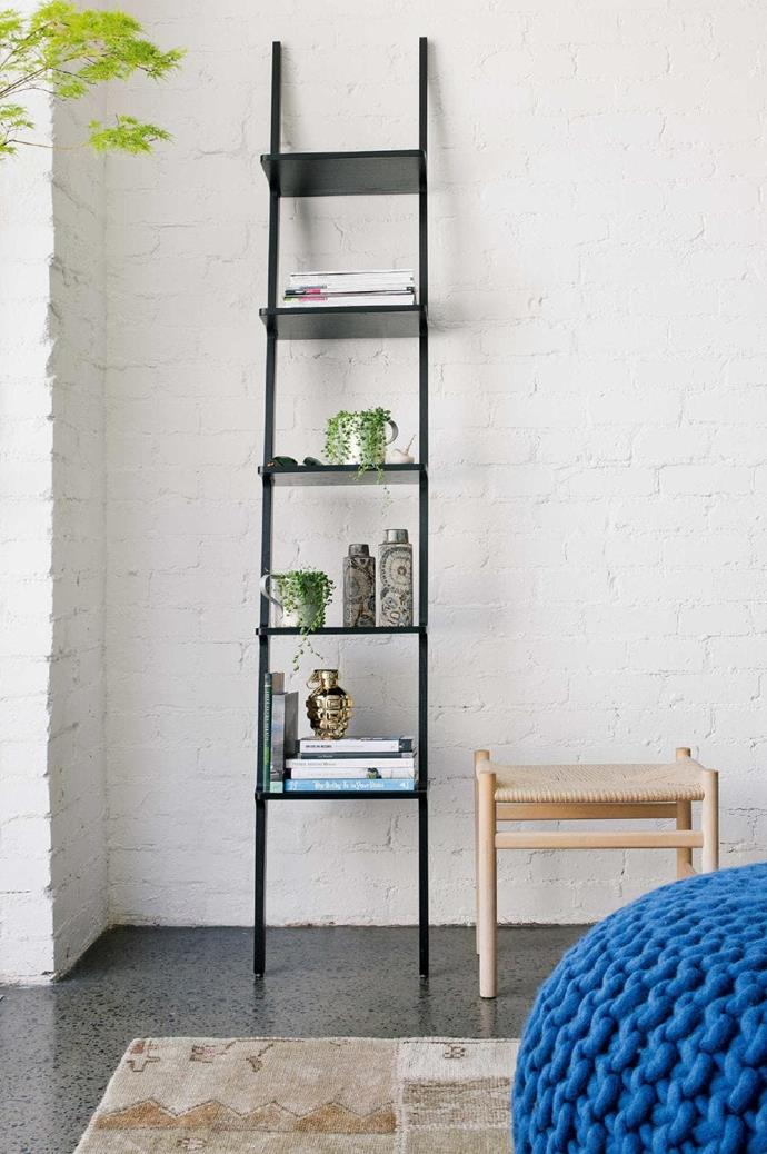 """Willowy [Scandinavian furniture](https://www.homestolove.com.au/scandinavian-style-homes-19651 target=""""_blank"""") maintains the flowing lights and uplifting quality of the living area."""