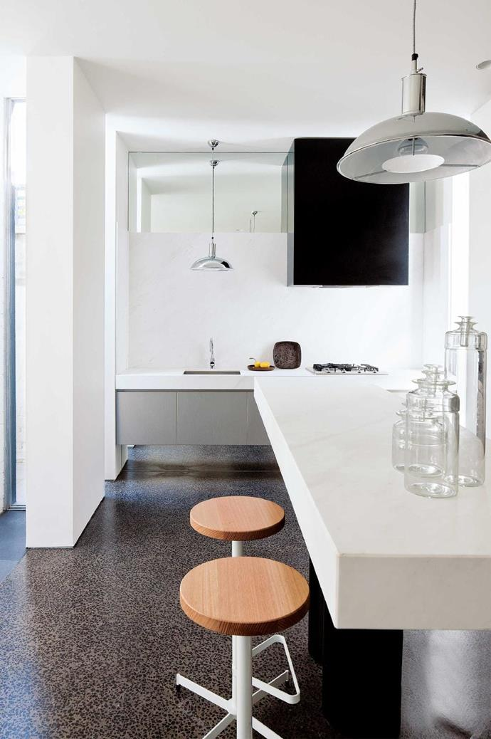 A mostly white colour scheme and cleverly positioned mirror maximises the amount of light reflected in the kitchen creating a light, bright and open space