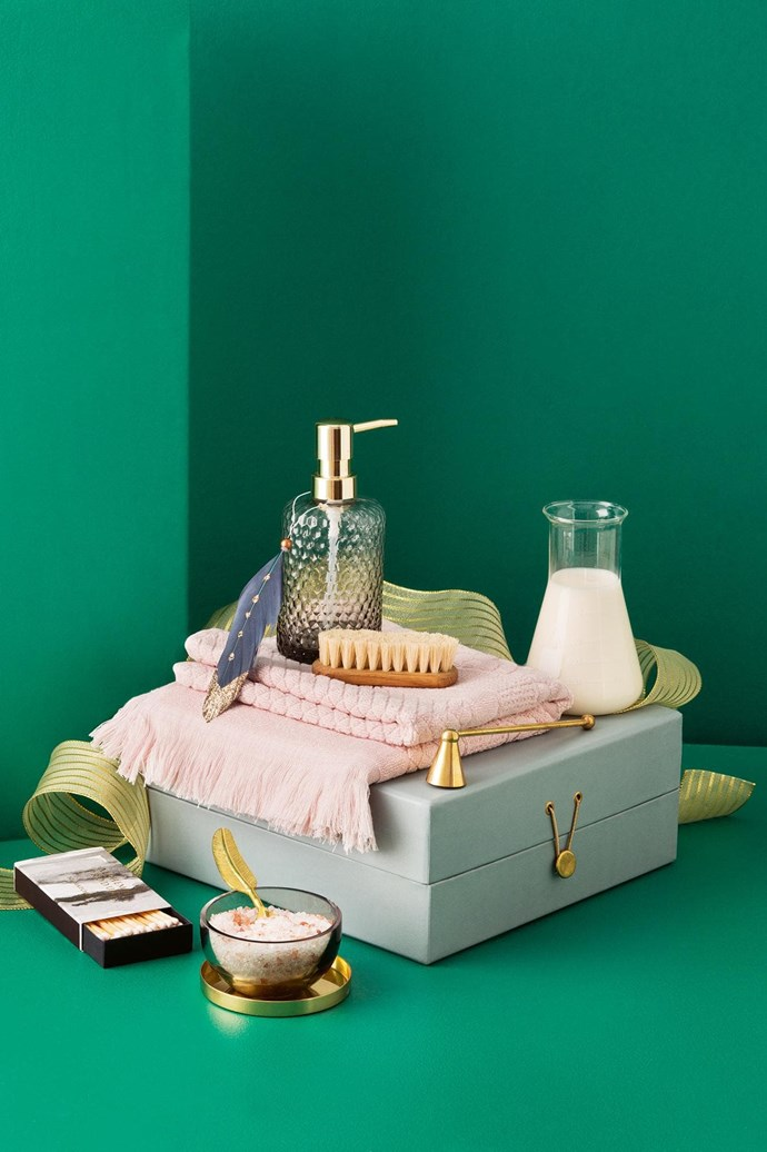 "**Pamper zone** Give the everyday bathroom routine a refined feel with a beautiful candle, a plush towel and pretty containers for an organised bliss-out space.  <br>**Tip** [Mix up a bath soak](https://www.homestolove.com.au/how-to-make-a-bath-soak-8383|target=""_blank"") and pick an elegant bowl to house it for spa-at-home luxury. You could even try making up a moisturiser, cleanser or scrub.   <br>**Products** Matches, $6/box of 50, Alchemy Produx. 'Metallic Mesh Stripes' ribbon in Gold, $7.85/10m, Koch & Co. AYTM 'Tota' bowl in Black/Brass, $59, Lo & Co Interiors. Brass teaspoon, $15, The Woodsfolk. Bloomingville glass soap dispenser, $34, Designstuff. Glitter feather decoration in Midnight, $4.95, Down To The Woods. Iris Hantverk 'Lovisa' nail brush, $18, Funkis. Jacquard hand towel in Dusk, $19.90, Città. Brass candle snuffer, $19, Zakkia. 'Sea Of Sage' conical flask candle, $45, Alchemy Produx. House Doctor storage box, $79/assorted pair, Lo & Co Interiors."