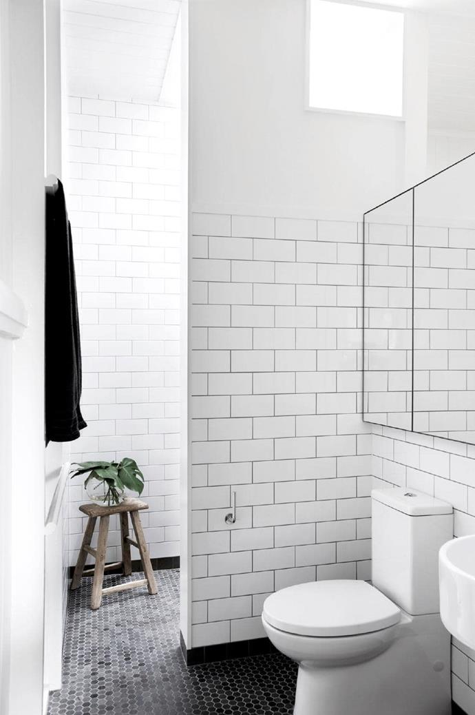 """Black grout proves a punchy choice in this [small-space bathroom](https://www.homestolove.com.au/small-bathroom-design-ideas-20211