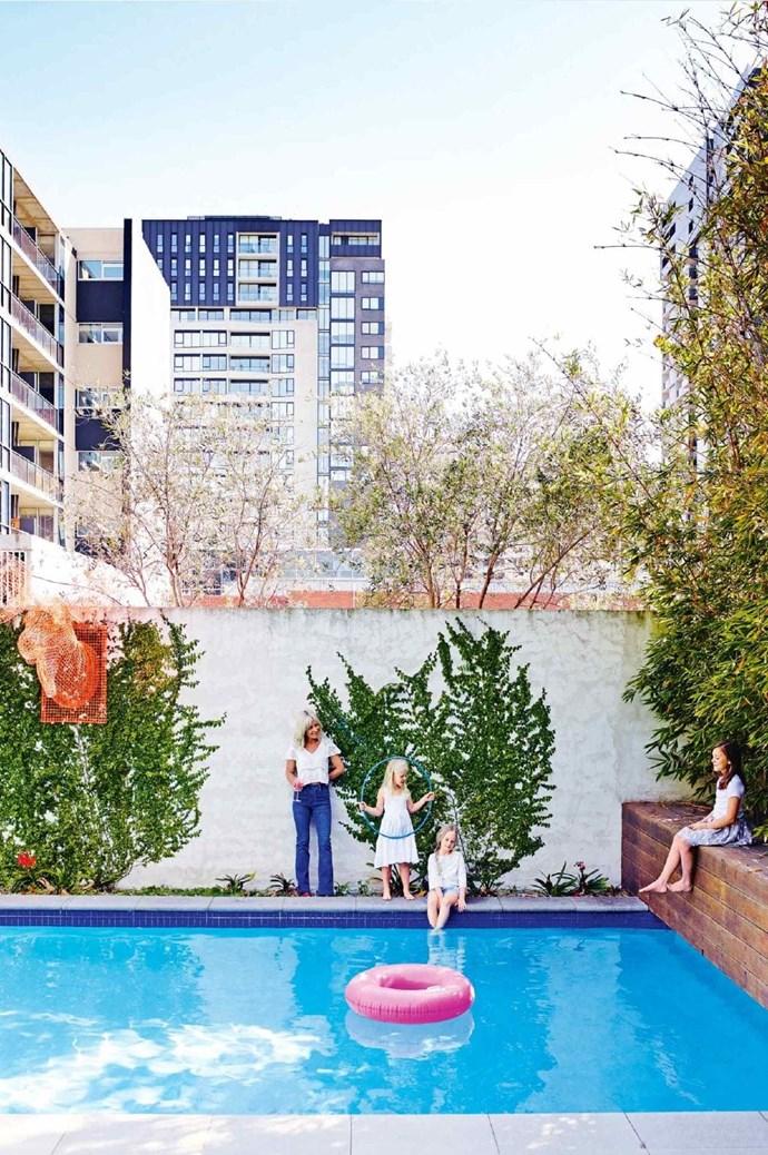 Despite its busy urban location, the creepers and trees help to soften this amazing pool area. Stylist: Heather Nette King, Photographer: Mark Roper
