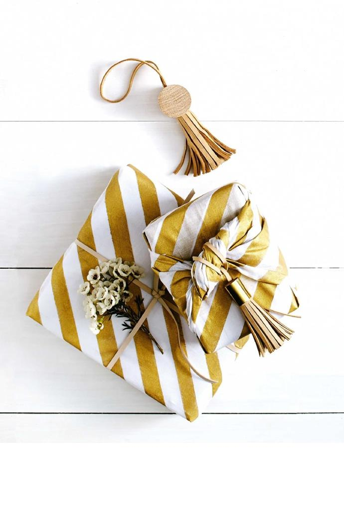 Feeling crafty? Make this cloth-style wrap from muslin hand-painted in gold, and tied with leather tassels that can be reused Photographer: Nigel Lough