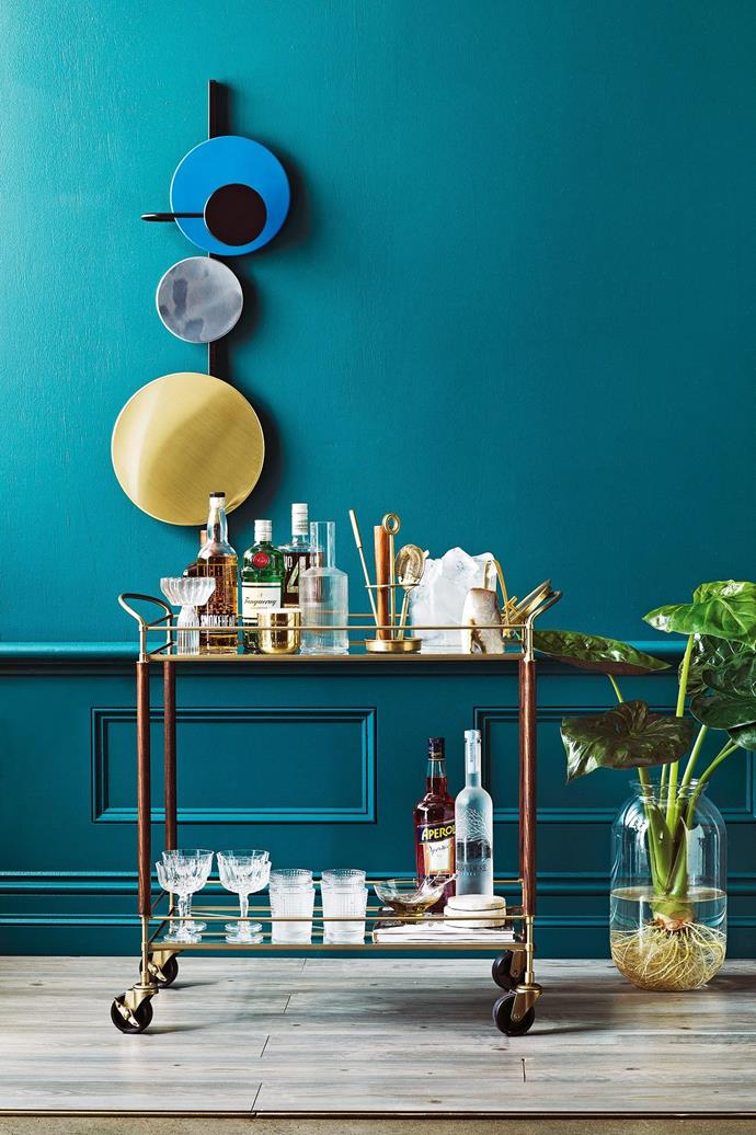 <b>Products</b> Mette Schelde 'Planet' wall lamp, $1700, Vela, vela.life. 'Brady' bar cart, $634, Pottery Barn, potterybarn.com.au. (On cart, from top left) Fferrone 'Margot' champagne coupe, $185/pair, Becker Minty. Tom Dixon Eclectic 'Orientalist' candle, $120, Safari Living, safariliving.com. Ferm Living 'Ripple' carafe, $59, Designstuff, designstuff.com.au. 'Bleecker' bar tool set, $94, and ice bucket and tongs, $94, all Pottery Barn. 'Agate' bookend, $39, West Elm, westelm.com.au. Italian cut-glass cocktail glasses, $15 each, The DEA Store, thedeastore.com. Noritake 'IVV Speedy' tumblers, $84/set of 6, Temple &amp; Webster, templeandwebster.com.au. 'Compot' yellow glass bowl, $75, The DEA Store. Stainless-steel cocktail picks, $13.15/set of 6, Bargeek. Petrified wood coasters, $79/set of 4, West Elm.  <i>Food styling by David Morgan, styling by Jono Fleming and photography by Jeremy Simons, with styling assistance form Romain Dossou-Yovo</i> Stylist: Jono Fleming and David Morgan, Photographer: Jeremy Simons