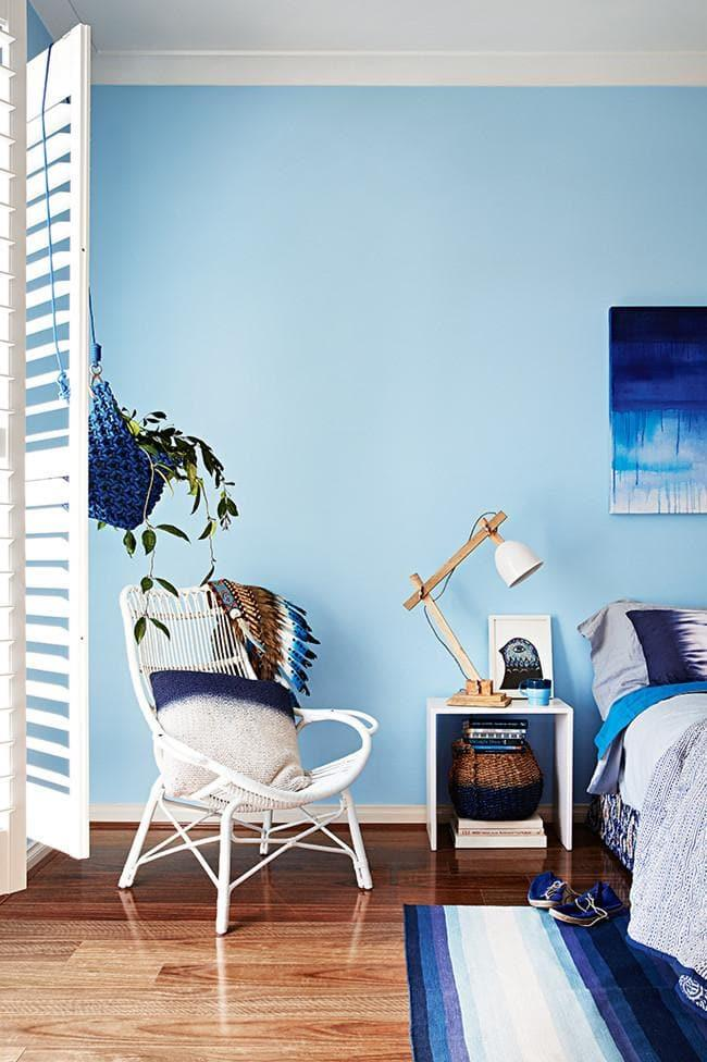 Blue shades make for an ideal bedroom colour palette because they have a calming effect. Liked this? Check out [1 living room 2 ways](http://www.insideout.com.au/home-style/modern-collector/how-to-style-a-living-room-2-ways) Stylist: Julia Green, Photographer: Armelle Habib