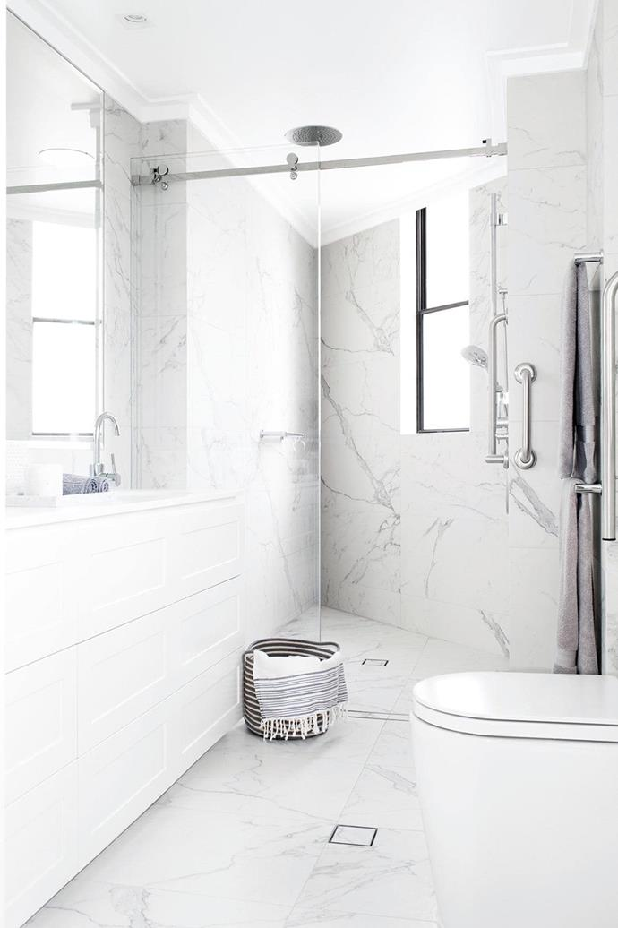 "Floor to ceiling [marble surfaces](https://www.homestolove.com.au/trend-alert-faux-marble-4063|target=""_blank"") and plenty of storage beneath the bathroom vanity will ensure this bathroom remains stylish and functional for years to come."