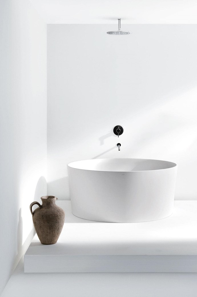 This minimalist white bathroom is so sleek it feels almost like an optical illusion.
