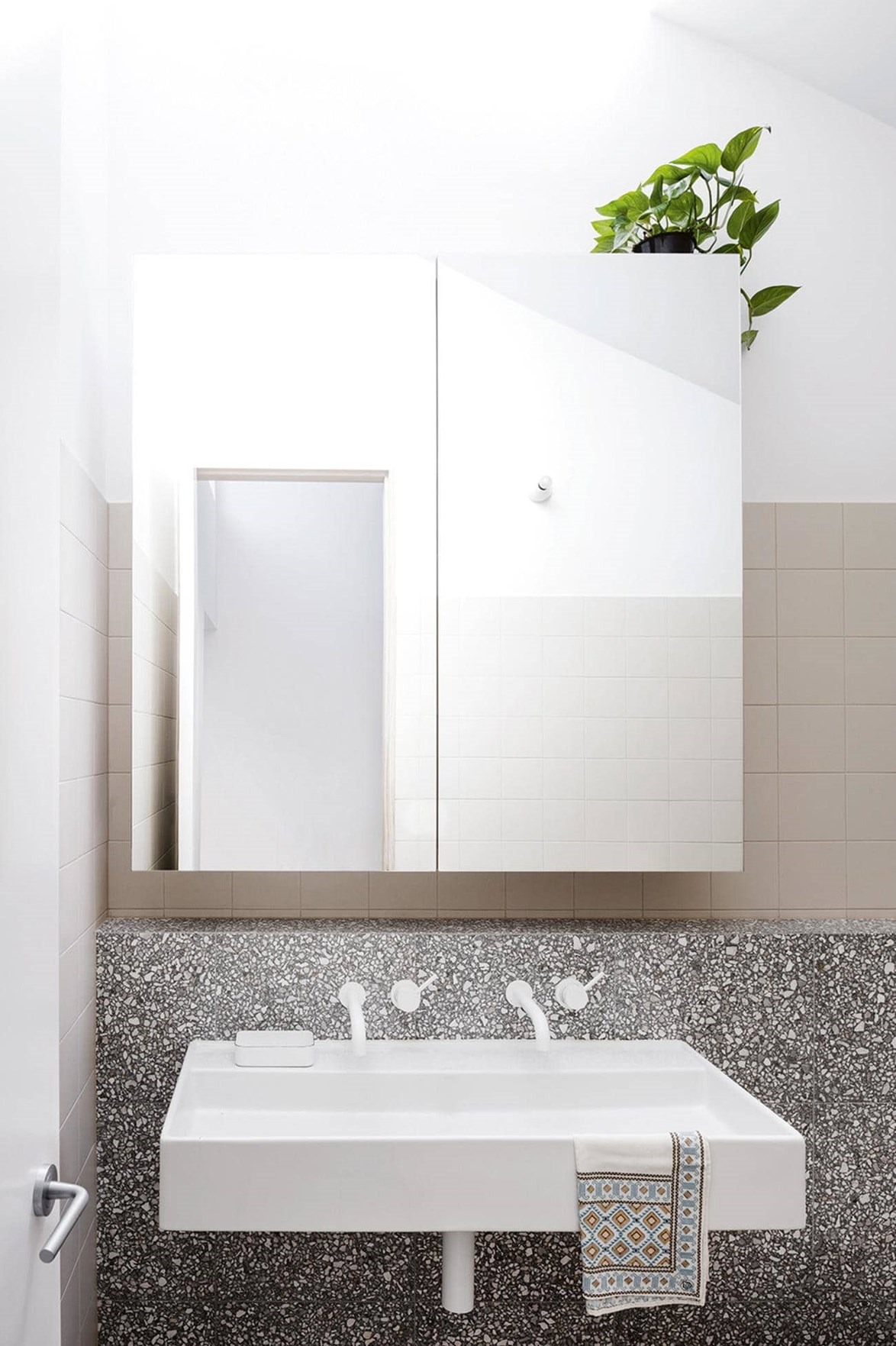 "This [tiny bathroom](https://www.homestolove.com.au/the-most-popular-bathrooms-of-2017-17662|target=""_blank"") is packed with style, from white tapware to millennial pink tiling and, you guessed it ... a sleek ledge of terrazzo goodness. *Story: Inside Out*"
