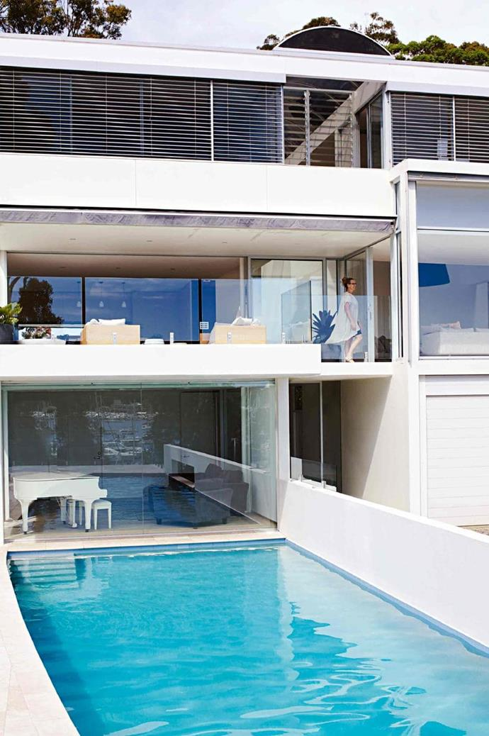 """This home makes the most of a beautiful locale and stunning water views with glass balustrades, floor to ceiling windows and a waterfront pool. >> [See more of this home](https://www.homestolove.com.au/spacious-light-filled-home-in-sydneys-northern-beaches-17198