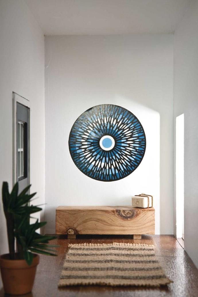 """The wall decal is by artist [Beastman](https://beastman.com.au/ target=""""_blank"""" rel=""""nofollow"""") and its lines contrast with a rug inspired by an Armadillo & Co design."""