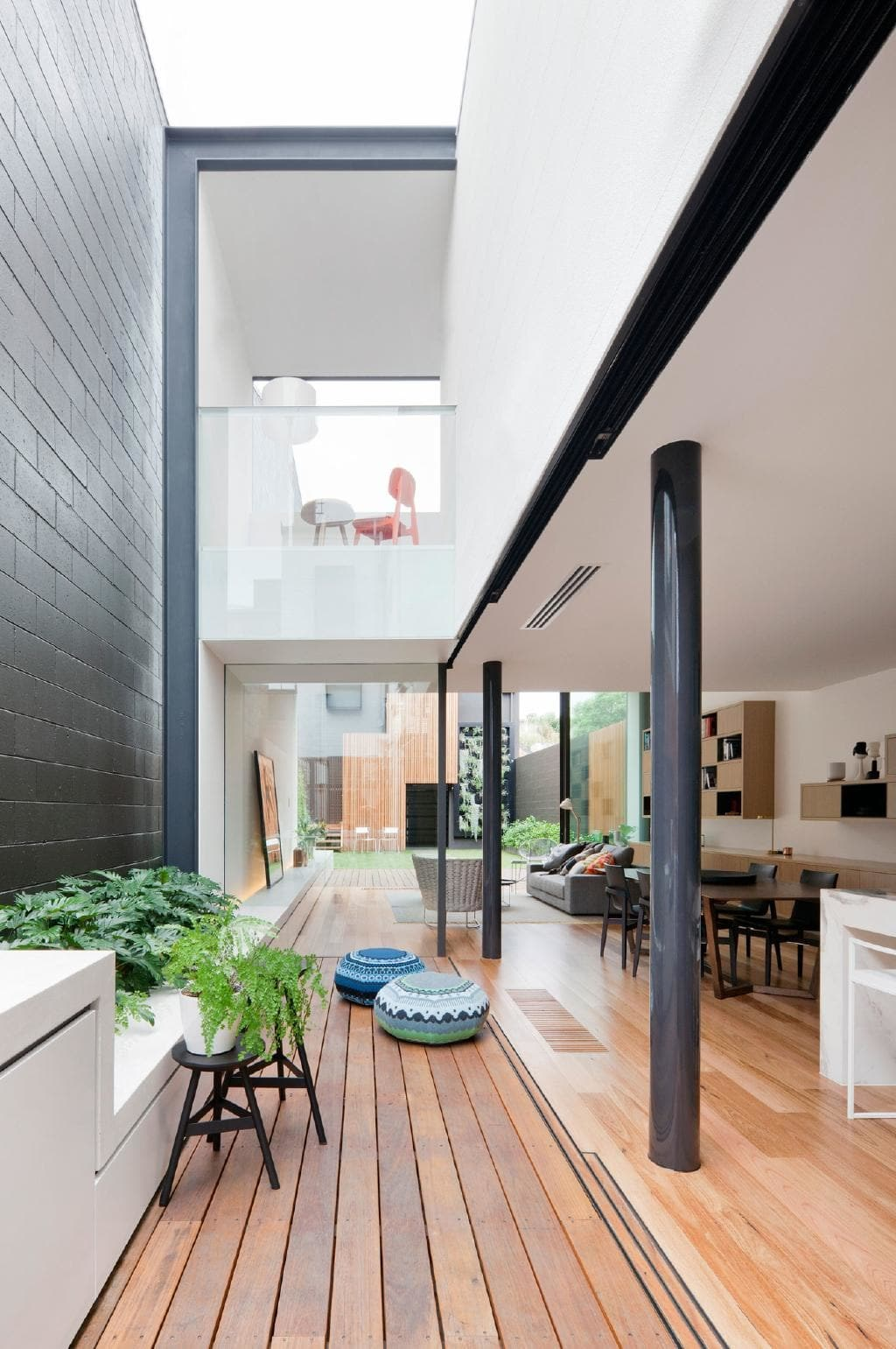 """Terrace homes are notorious for their lack of natural sunlight, but you'd never know it looking at this [standout family home](https://www.homestolove.com.au/internal-courtyard-ideas-to-light-up-your-home-18778