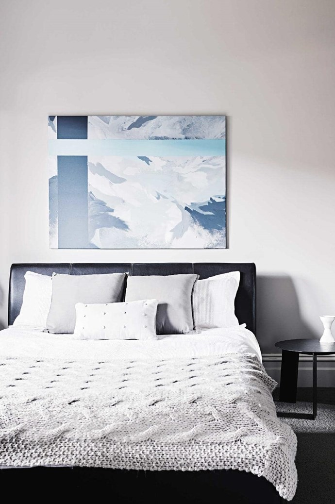 Artwork doesn't have to be loud - this calming print is perfect for a serene bedroom Photographer: Brooke Holm, Stylist: Marsha Golemac