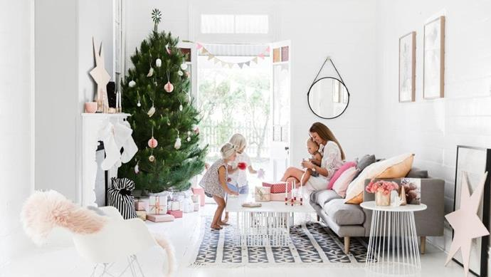 Homeowner Lee helps her kids Bertie, Otis and Rufus with their festive decorating. A pine tree is dressed with feather clusters and a topper from [The Woodsfolk](http://www.thewoodsfolk.com.au), paper ornaments from [iConnect Products](http://www.iconnectproducts.com.au/) and [Nordic Designs](https://nordicdesignshome.com.au/) stars. Soft pinks create a joyful vibe, with a [Lightly](https://www.lightly.com.au) rug and cushions from [Kip & Co](https://kipandco.com.au), [Lightly](http://lightly.com.au) and [GlobeWest](http://www.globewest.com.au/) on an [Oz Design Furniture](https://www.ozdesignfurniture.com.au/) sofa