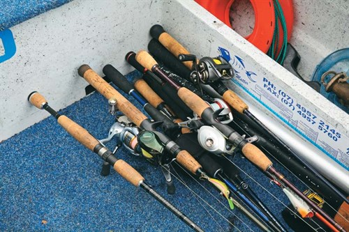 Unsecured fishing rods in a trailer boat