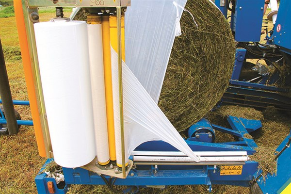 Net Film The Three Roller Tensioners On The Wrapping Heads Ensure Even Tightly Wrapped Bales