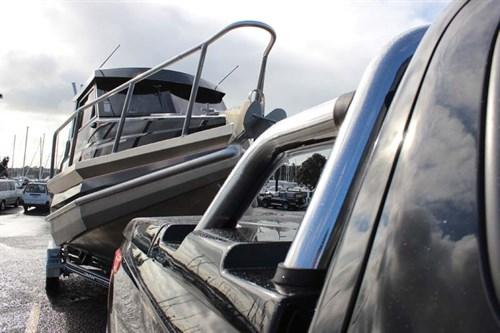 Mitsubishi Triton towing a boat