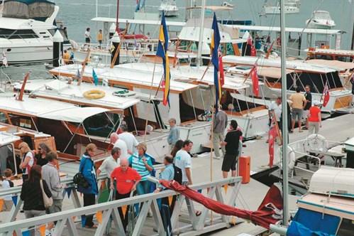 Wooden boat show at marina.