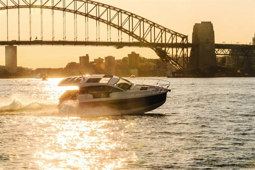 Luxury boat under Sydney Harbour Bridge