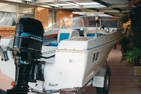 Blue band Mercury outboard on Caribbean boat