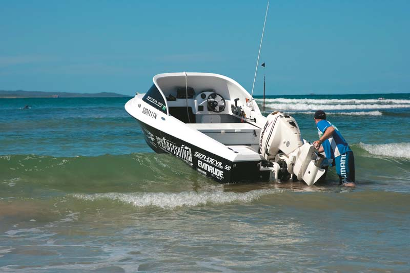 Beach launching a runabout boat