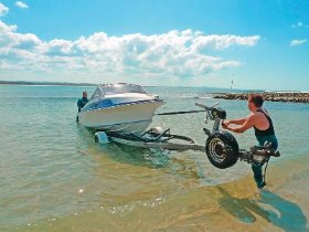 Retrieving a boat trailer from a beach launch