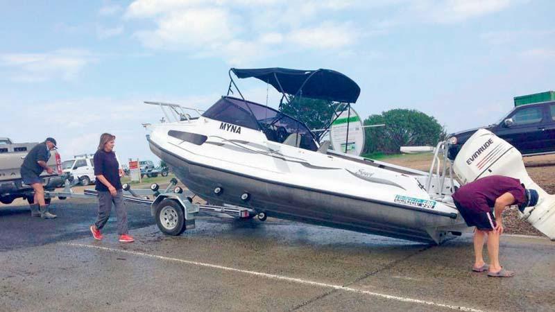 Trailer boat stranded on boat ramp