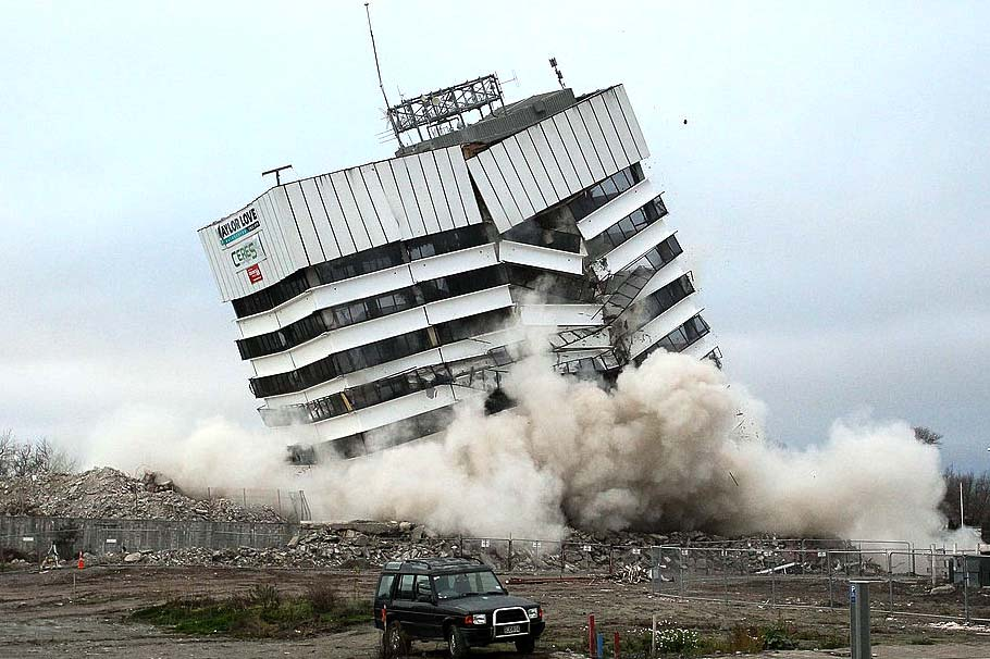 Demolished building imploding