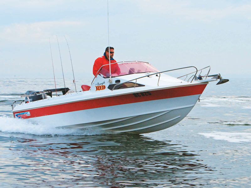Haines Hunter 560F boat on the water